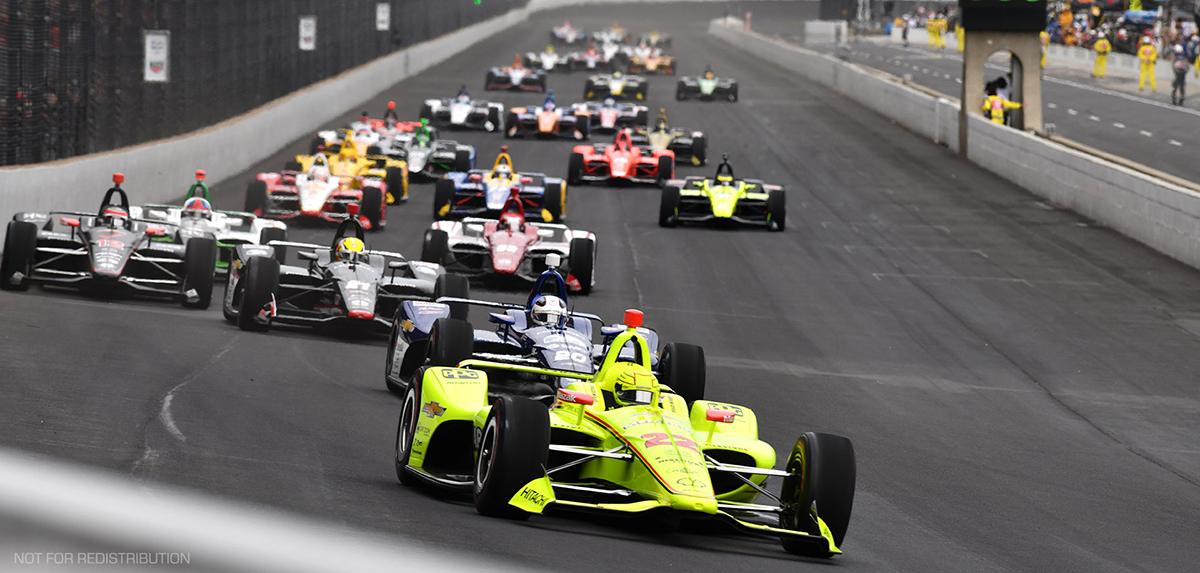 Race cars on Track at Indianapolis Motor Speedway