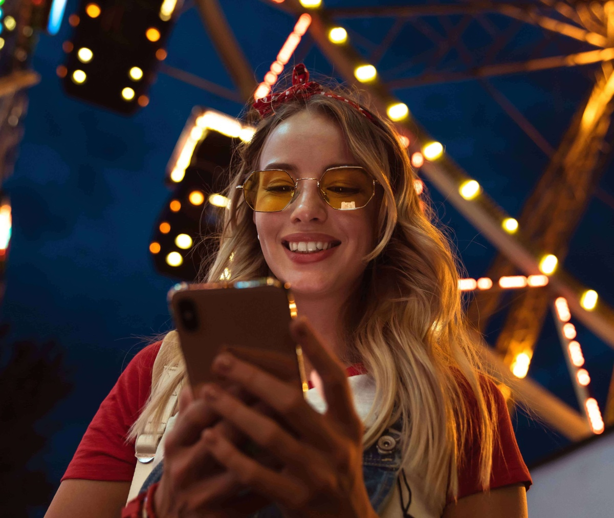 Woman looking at mobile screen at music festival